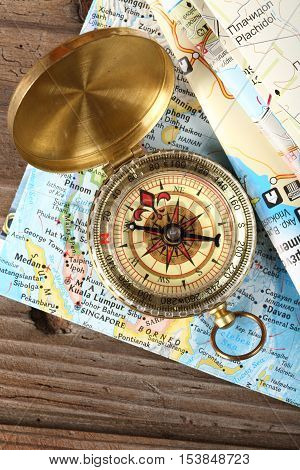 compass and maps close up on wood