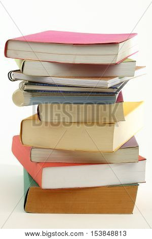 stack of books over white close up
