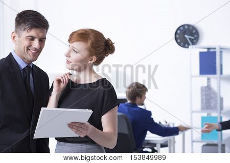 Women Showing Reports To Her Boss