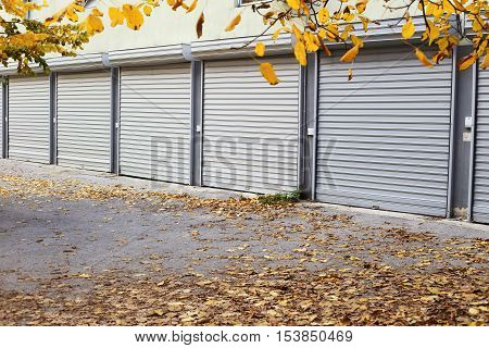 autumn metal doors of garages with leaves