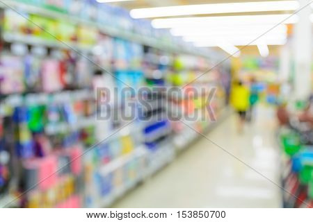 People Shopping In Supermarket