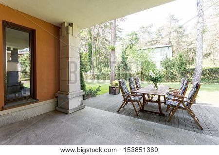 Veranda With Wooden Table And Chairs