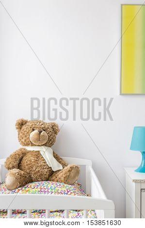 Sweet Teddy Bear In A Cradle
