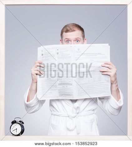 Man Holding The Daily Newspaper
