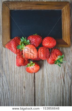 Strawberry on Wood with Blank Black Board