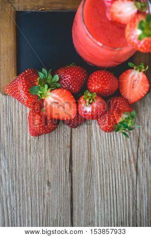 Strawberry Slush on Wood with Blank Black Board Summer Drink Fresh Drink