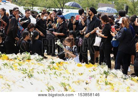 Bangkok Thailand -OCT 23 2016: A crowd of mourners at Sanam Luang while the body of Thailand Bhumibol Adulyadej is taken from the hospital to the Temple of the Emerald Buddha in Bangkok