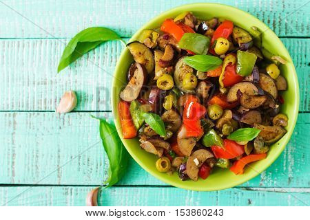 Hot Spicy Stew Eggplant, Sweet Pepper, Olives And Capers With Basil Leaves. Top View