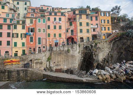 Riomaggiore Italy - October 24 2016: Buildings and boats in Riomaggiore city in Liguria Italy. One of five Cinque Terre cities