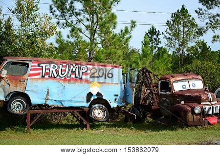 WAYCROSS, GA - OCT. 28, 2016 Old junkyard van seen from the Route 1 shows support for Republican Presidential Candidate Donald Trump.