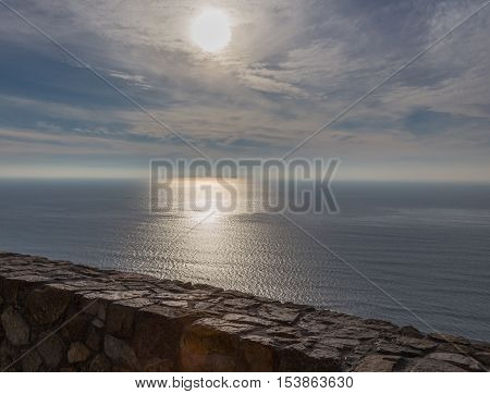 Looking out at the Pacific Ocean from Point Loma on a bright January afternoon. Shows a calm sea with blue sky with clouds.