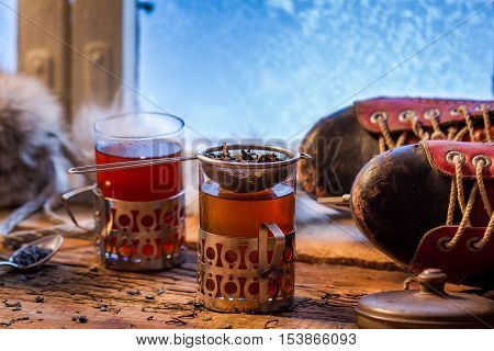 Warming tea in a winter day on old wooden table