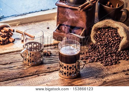 Enjoy your coffee in winter day on old wooden table