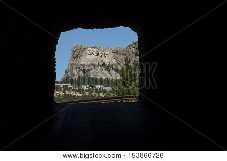 A view of Mount Rushmore through a tunnel.