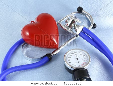 Medical Stethoscope Head And Red Toy Heart Lying On Cardiogram Chart Closeup. Help, Prophylaxis, Dis