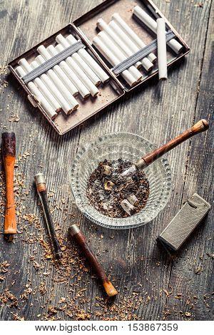 Vintage stuff to smoke a pipe on old wooden table