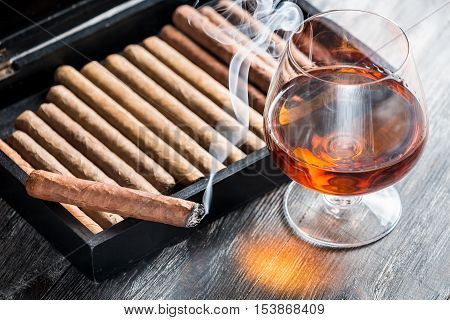 Aroma Of Cognac And Smoking A Cigar