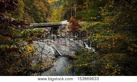 Great Smoky Mountains Autumn Road Trip. Bridge over the roadside Sinks waterfall on Little River Road in the Great Smoky Mountains National Park. Gatlinburg, Tennessee.
