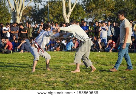 Istanbul Turkey - October 2 2016: The Central Asian Turkmen meadow wrestling held in Istanbul. Zeytinburnu district of Istanbul in the meadow Turkmen Uzbek Afghan Tatar Kyrgyz and other Central Asian Turkmen done wrestling. Wrestling following türkmenler
