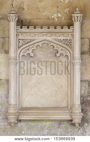 Rustic stone sign with space for text. 13th Century sign with decorative edges.