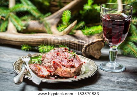Fresh Venison On A Plate And Red Wine