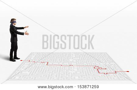 3D Rendering Hand draws and help a blindfolded businessman to  way out of the maze
