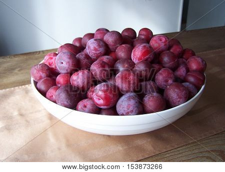 Large bowl of Toka plum fruit on the table