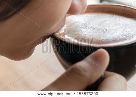 Woman drinking hot coffee latte stock photo