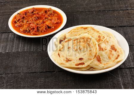 Delicious Indian street food -Paratha with spicy and tasty mutton curry.