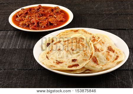 Indian street food -Paratha with spicy and tasty mutton curry.