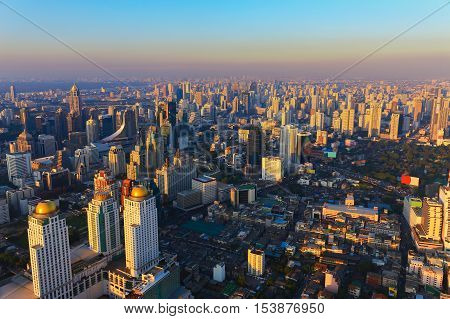 Aerial view Bangkok city downtown with sunset tone, Thailand