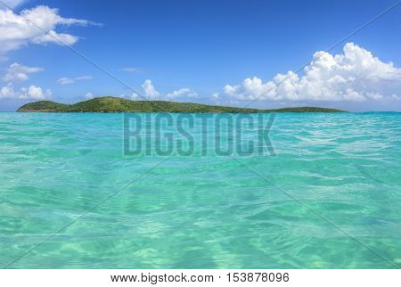 Unpopulated North Cay with green vegetation and shallow turquoise water of Zoni Beach on Isla Culebra on beautiful sunny day
