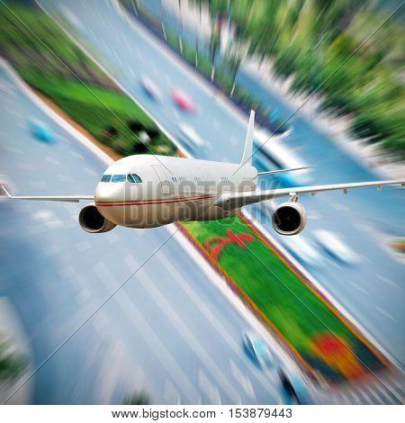 The plane flew over the city motorway.