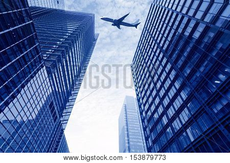 The plane flew over high-rise buildings in Shanghai.