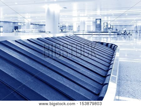 A baggage conveyor in an airport terminal.