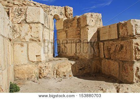 Inside a medieval castle arrow slit in the historic wall of Old Jerusalem, Israel.