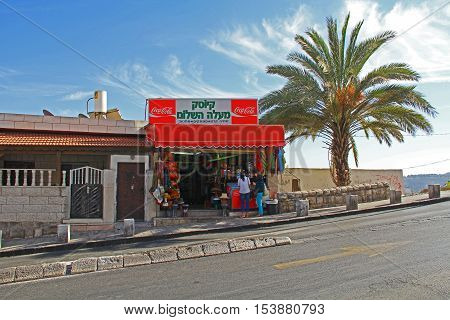 Jerusalem, Israel, October 24, 2013, Two  female tourists shopping in a roadside store just outside of Old Jerusalem, Israel.