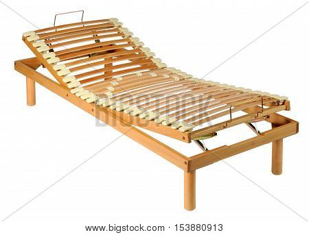 Wooden orthopaedic net on an adjustable wood bed frame isolated on white in a three quarter view
