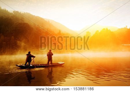 Early morning lake and the two fishermen