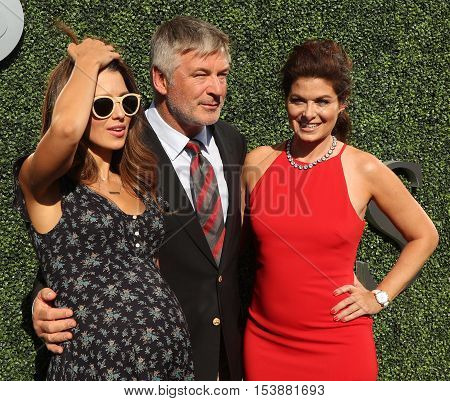 NEW YORK - AUGUST 29, 2016: Hilaria Thomas (L), Emmy Award winners Alec Baldwin and Debra Messing attend US Open 2016 opening ceremony at USTA Billie Jean King National Tennis Center in New York