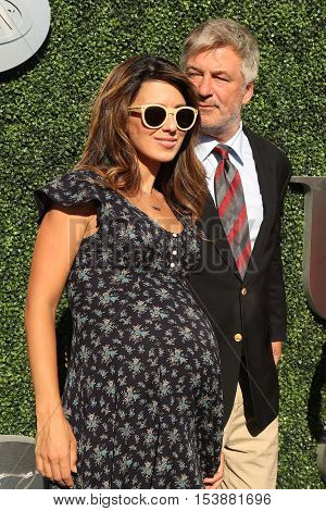 NEW YORK - AUGUST 29, 2016: Hilaria Thomas (L) and Emmy Award winners Alec Baldwin attend US Open 2016 opening ceremony at USTA Billie Jean King National Tennis Center in New York
