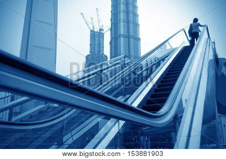 Shanghai street modern building skyscraper building escalator. poster
