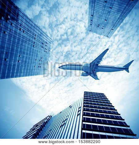 The plane flew over the high-rise buildings in the city.
