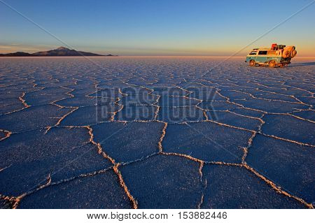 Van on Salar de Uyuni, salt lake, is largest salt flat in the world, altiplano, Bolivia, South America