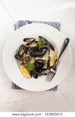 scottish cooked mussels in a deep dish with parsley and lemon