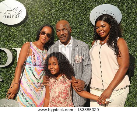 NEW YORK - AUGUST 29, 2016: Former boxing champion Mike Tyson (center) with family attend US Open 2016 opening ceremony at USTA Billie Jean King National Tennis Center in New York