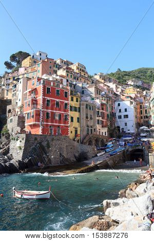 Riomaggiore, Italy - June 27, 2016: Port of village Riomaggiore with colorful houses. Riomaggiore is one of the five villages in Cinque Terre and famous for its colorful houses.
