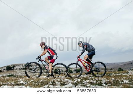 Privetnoye Russia - September 21 2016: two cyclist mountainbiker sports bike ride on a mountain trail during Crimean race mountainbike