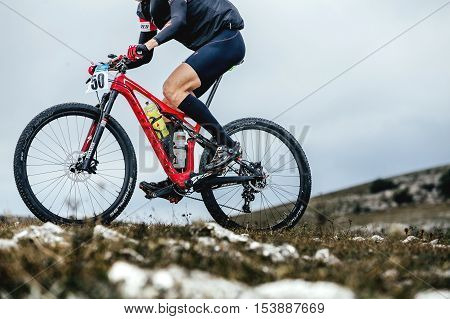 Privetnoye Russia - September 21 2016: closeup male cyclist mountainbiker sports bike ride on a mountain trail during Crimean race mountainbike