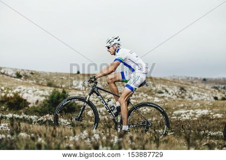 Privetnoye Russia - September 21 2016: male riders cyclists mountenbike ride a mountain trail during Crimean race mountainbike